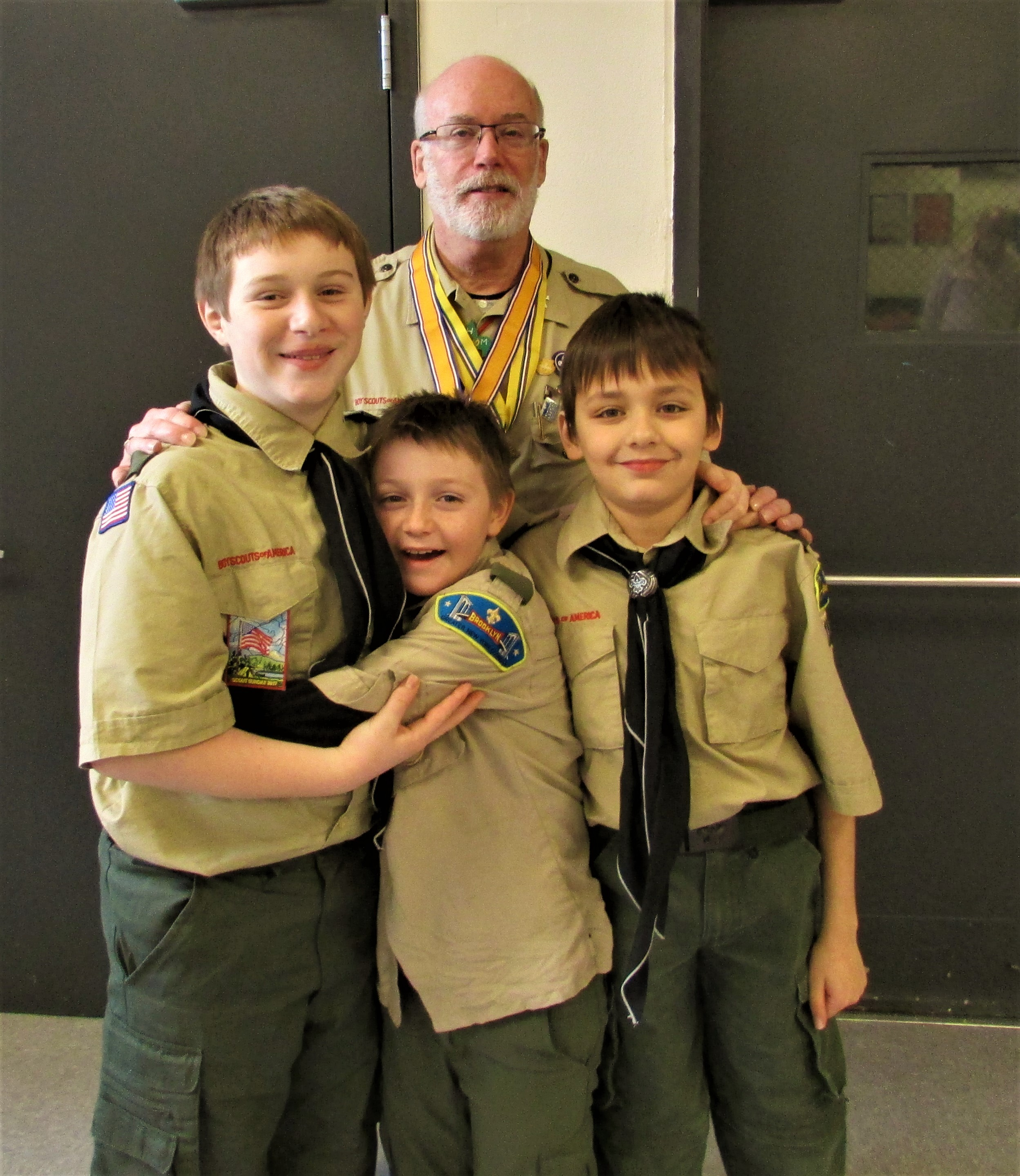 Deacon Jim Noble with some Troop 187 Scouts